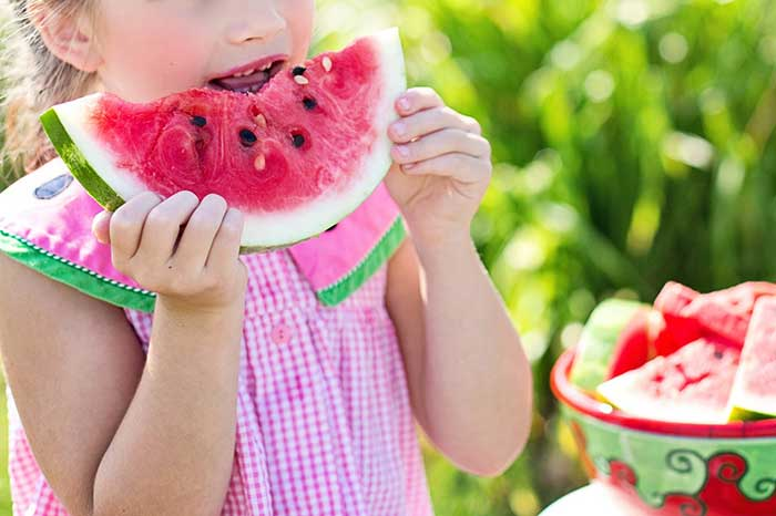 kid eating watermellon