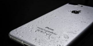 wet iPhone 7 on balck surface