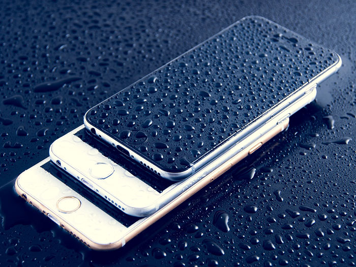 iPhone with water drops on it