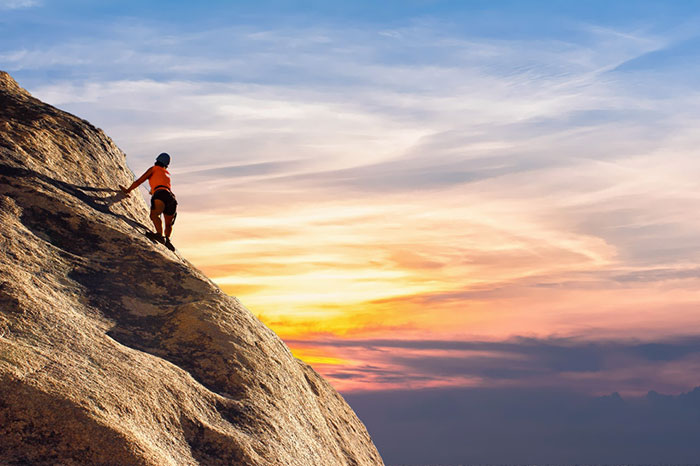 Highly motivated person climbing a mountain