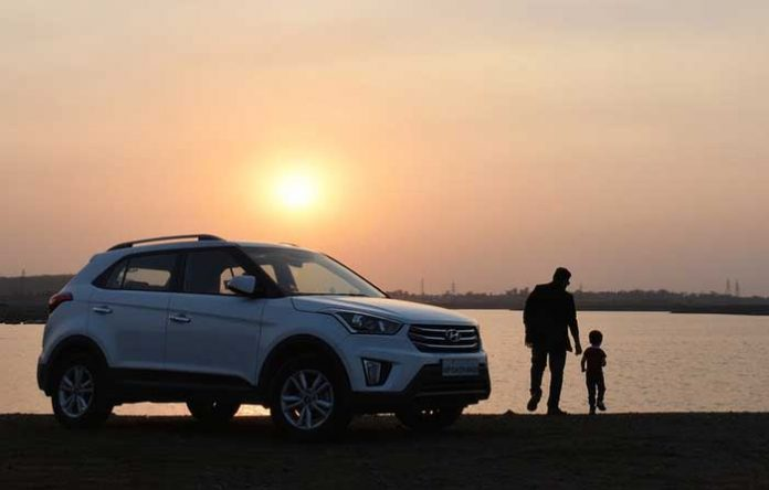 Sunset and family car