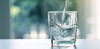 Adobe Stock royalty-free image #159675117, 'Close up the pouring purified fresh drink water from the bottle on table in living room' uploaded by Cozine, standard license purchased from https://stock.adobe.com/images/download/159675117; file retrieved on November 26th, 2018. License details available at https://stock.adobe.com/license-terms - image is licensed under the Adobe Stock Standard License